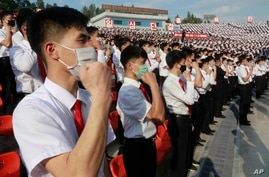 North Korean students stage a rally to denounce South Korea following that defectors and other activists in South Korea flew…