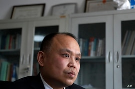 FILE - In this Feb. 24, 2017, file photo, prominent legal activist Yu Wensheng pauses during an interview at his office in…