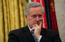 White House chief of staff Mark Meadows listens during a meeting on the coronavirus response between President Donald Trump and…