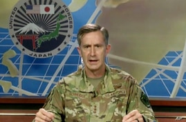 In this image made from an online news conference provided by U.S. Forces Japan, Lt. Gen. Kevin Schneider, Commander of the U.S…