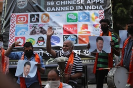 Activists of Jammu and Kashmir Dogra Front shout slogans against Chinese President Xi Jinping during a protest in Jammu, India,…