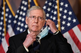 Senate Majority Leader Mitch McConnell of Ky., listens to a question during a news conference on Capitol Hill in Washington,…