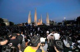 Thai anti-government protesters gather front of the Democracy Monument in Bangkok, Thailand, Saturday, July 18, 2020. Several…