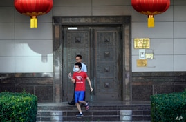 Visitors to the Chinese Consulate General leave after trying to gain entry Wednesday, July 22, 2020, in Houston. Houston police…