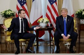 President Donald Trump meets French President Emmanuel Macron at Winfield House, Tuesday, Dec. 3, 2019, in London. (AP Photo/…