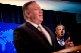 Secretary of State Mike Pompeo, accompanied by Assistant Secretary for the Bureau of Energy Resources Francis Fannon, right,…