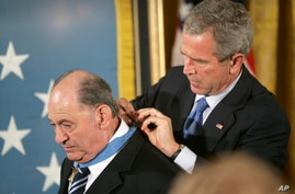 FILE -In this Sept. 23, 2005 file photo, President Bush presents the Medal of Honor to Cpl. Tibor Rubin, in the East Room at…