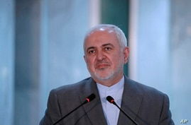 Iranian Foreign Minister, Mohammad Javad Zarif, speaks during a press conference with his Iraqi counterpart, Fouad Hussein…