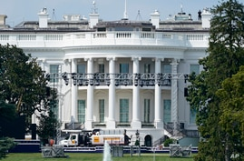 Lights and staging stand on the South Lawn of the White House, Friday, Aug. 21, 2020, in Washington. President Donald Trump is…