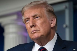 President Donald Trump pauses while speaking during a media briefing in the James Brady Briefing Room of the White House,…