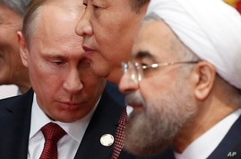 Russian President Vladimir Putin, left, and Chinese President Xi Jinping, center, and Iran's President Hassan Rouhani share a…