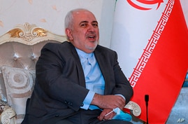 Iranian Foreign Minister Mohammad Javad Zarif meets with his Iraqi counterpart Fouad Hussein, not in photo, in Baghdad, Iraq,…