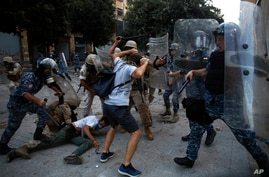 Protesters clash with police during a protest against the political elites and the government after this week's deadly…