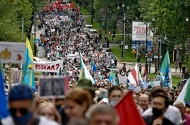 People march during an unsanctioned protest in support of Sergei Furgal, the governor of the Khabarovsk region, in Khabarovsk,…