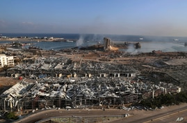 This photo shows a general view of the scene of an explosion that hit the seaport of Beirut, Lebanon, Wednesday, Aug. 5, 2020…