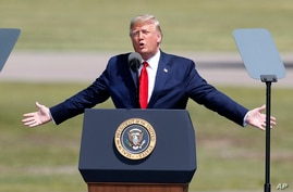 President Donald Trump speaks at a campaign stop at North Star Aviation in Mankato, Minn., Monday, Aug. 17, 2020. (AP Photo/Jim…