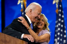 Democratic presidential candidate former Vice President Joe Biden hugs his wife Jill Biden after his speech during the fourth…