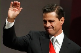 Mexican President Enrique Pena Nieto waves to supporters after delivering his sixth and final State of the Nation address at…