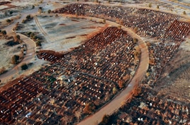Recently filled graves are seen in the Olifantsveil Cemetery outside Johannesburg, South Africa, Wednesday Aug. 5, 2020. The…