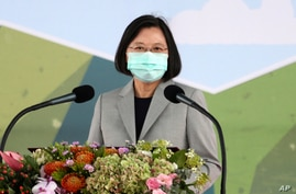 Taiwanese President Tsai Ing-wen delivers a speech as she inaugurates an F-16 maintenance center at the Aerospace Industrial…