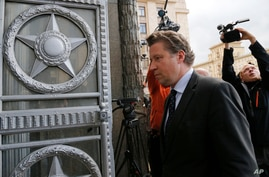 German Ambassador to Russia Geza Andreas von Geyr enters the Russian Foreign Ministry in Moscow, Russia, Wednesday, Sept. 9,…