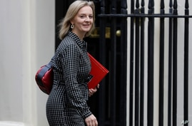 Britain's Secretary of State for International Trade Elizabeth Truss arrives for a Cabinet meeting at 10 Downing Street in…
