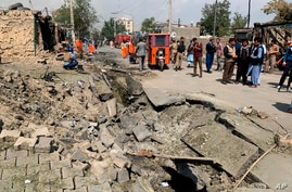 Afghan security personnel and Municipality workers work at the site of an explosion in Kabul, Afghanistan, Wednesday, Sept. 9,…