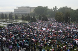 Riot police line block the road to stop Belarusian opposition supporters rally near the Palace of Independence, on the…
