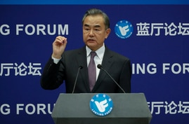 Chinese Foreign Minister Wang Yi gestures as he speaks during the Lanting Forum on the International Order and Global…