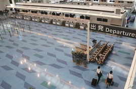 A departure lobby of Haneda International Airport is quiet with little travel due to the coronavirus COVID-19 in Tokyo, Tuesday…