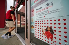 This is a help wanted sign on the door of a Target store in Uniontown, Pa., on Wednesday, Sept. 2, 2020. (AP Photo/Gene J…