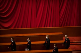 Delegates arrive for the closing session of China's National People's Congress (NPC) at the Great Hall of the People in Beijing…
