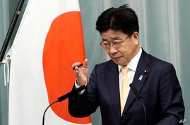 Katsunobu Kato, newly appointed Chief Cabinet Secretary, speaks during a press conference at the prime minister's official…