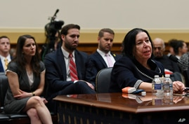 With her family sitting behind her, Christine Levinson, wife of Robert Levinson, a former FBI agent who vanished in Iran in…
