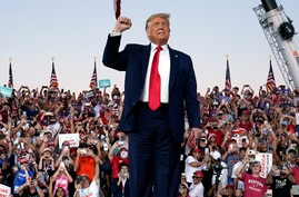 President Donald Trump arrives for a campaign rally at Orlando Sanford International Airport, Monday, Oct. 12, 2020, in Sanford…