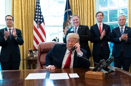 President Donald Trump talks on a phone call with the leaders of Sudan and Israel, as Treasury Secretary Steven Mnuchin, left,…