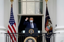 President Donald Trump arrives to speak from the Blue Room Balcony of the White House to a crowd of supporters, Saturday, Oct…