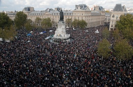 Hundreds of people gather on Republique square during a demonstration Sunday Oct. 18, 2020 in Paris. Demonstrations around…