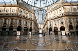A city police officer walks in the Vittorio Emanuele II gallery shopping arcade in downtown Milan, Italy, Friday, Nov. 6, 2020…