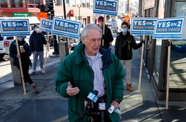 Sen. Edward Markey, D-Mass., speaks with reporters while campaigning, Saturday, Oct. 31, 2020, in Cambridge, Mass. (AP Photo…