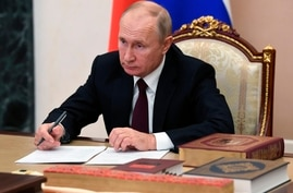 Russian President Vladimir Putin attends a conference a meeting with heads of religious confessions via video conference during…