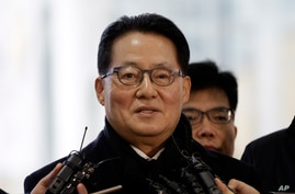 Park Jie-won, a lawmaker of South Korean opposition New Politics Alliance for Democracy, speaks to the media before leaving for…