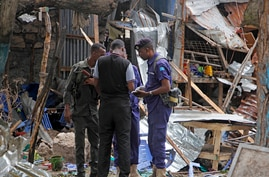 Security forces gather in the remains of destroyed houses after a suicide bomb attack in Mogadishu, Somalia Tuesday, Nov. 17,…