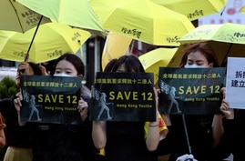 Supporters gather, holding slogan to demand the release of the 12 Hong Kong protesters that have been arrested by mainland…