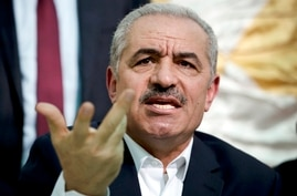 FILE - In this Wednesday, Jun. 24, 2020 file photo, Palestinian Prime Minister Mohammad Shtayyeh speaks during the leadership…