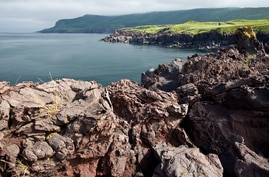 In this Sunday, Aug. 21, 2011 photo  lava-sediment of Bogdan Khelmintsky Volcano seen in Iturup Island, Russian Far East. (AP…