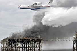 "Russian Beriev-200 amphibious multi-purpose aircraft drops water to burning oil platform during ""Kaliningrad 2004"" NATO and Russia joint anti-terrorist exercises, Baltic Sea, Khmelevka, near Kaliningrad, Russia, photo"