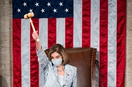 Speaker of the House Nancy Pelosi of Calif., waves the gavel on the opening day of the 117th Congress on Capitol Hill in…