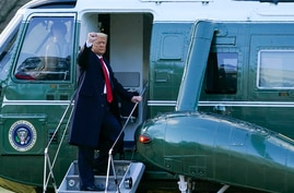 President Donald Trump gestures as he boards Marine One on the South Lawn of the White House, Wednesday, Jan. 20, 2021, in…