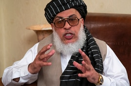 FILE - Sher Mohammad Abbas Stanikzai, the Taliban's chief negotiator, speaks to reporters after talks in Moscow, Russia,in a…